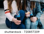 Two Womans Holding Pepsi