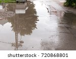 Small photo of Water accumulate in the puddle on the asphalt road in the hole after heavy rain