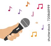 the hand holds the microphone.... | Shutterstock .eps vector #720868999