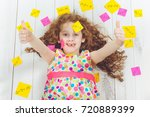 happy girl with stickers on his ... | Shutterstock . vector #720889399