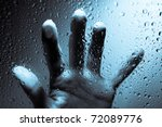 Hand Behind Wet Window