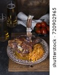 Small photo of Pork knuckle with beer and sauerkraut. Oktoberfest still life