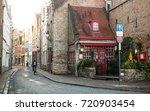 the old street in bruges ... | Shutterstock . vector #720903454