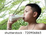 an asian boy drinking milk... | Shutterstock . vector #720906865