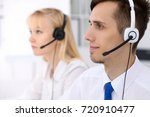 young business man in headset....   Shutterstock . vector #720910477