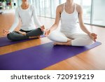 meditating females sitting on... | Shutterstock . vector #720919219