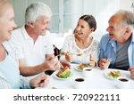 cheerful senior friends having... | Shutterstock . vector #720922111