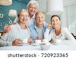 company of affectionate senior... | Shutterstock . vector #720923365