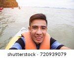 man selfie fun enjoy travel on... | Shutterstock . vector #720939079
