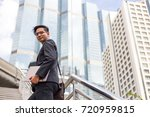 business man with his laptop...   Shutterstock . vector #720959815