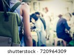 girl with backpack entering to... | Shutterstock . vector #720964309