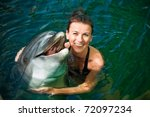 Girl Hugging A Dolphin In The...