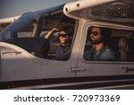 beautiful couple in aviation... | Shutterstock . vector #720973369