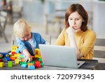 adorable little boy playing... | Shutterstock . vector #720979345