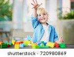 adorable little boy playing... | Shutterstock . vector #720980869