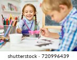 portrait of adorable little... | Shutterstock . vector #720996439