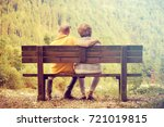 couple sitting outdoors in... | Shutterstock . vector #721019815