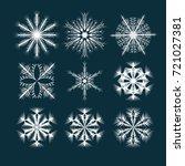 vector set of white snowflakes... | Shutterstock .eps vector #721027381