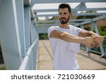 stretching for training outdoors | Shutterstock . vector #721030669