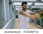 man stretching for training... | Shutterstock . vector #721030711