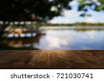 image of wooden table in front... | Shutterstock . vector #721030741