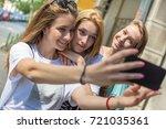 teenage girls taking a selfie... | Shutterstock . vector #721035361