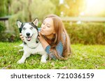 girl playing with a dog outdoors | Shutterstock . vector #721036159