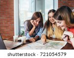 three female students doing... | Shutterstock . vector #721054579