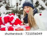 beautiful woman with christmas... | Shutterstock . vector #721056049