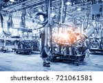 robots welding in a car factory | Shutterstock . vector #721061581
