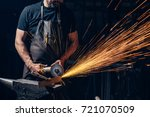 worker using angle grinder in... | Shutterstock . vector #721070509