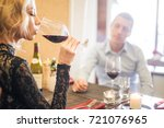 elegant blonde lady with glass... | Shutterstock . vector #721076965