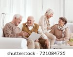 senior friends are laughing and ... | Shutterstock . vector #721084735