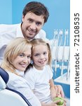 Young family at a reception at the dentist - stock photo