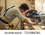 carpenters cutting wooden plank ...   Shutterstock . vector #721088281