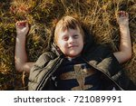 smiling boy lying on  autumn... | Shutterstock . vector #721089991