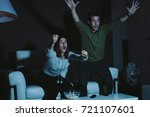 young couple cheering their... | Shutterstock . vector #721107601