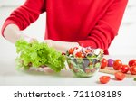 unrecognizable woman cooking... | Shutterstock . vector #721108189