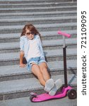 little girl posing with scooter ... | Shutterstock . vector #721109095