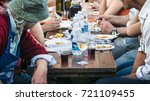 people eating in a town... | Shutterstock . vector #721109455