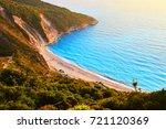 sunset at famous myrtos beach   ... | Shutterstock . vector #721120369