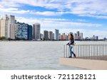 female tourist admiring chicago ... | Shutterstock . vector #721128121