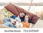 hipster couple on a trip to the ... | Shutterstock . vector #721145569