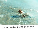 a bottle with a message is... | Shutterstock . vector #721151095