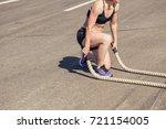 women with battle rope battle... | Shutterstock . vector #721154005