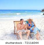 senior couple sitting on deck... | Shutterstock . vector #72116044