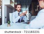 young handsome businessman in... | Shutterstock . vector #721183231