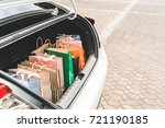 shopping bags in car trunk or... | Shutterstock . vector #721190185