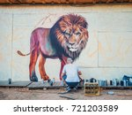 graffiti artist painting on the ... | Shutterstock . vector #721203589