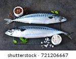 Stock photo fresh raw mackerel with spices on a black concrete background 721206667